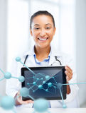 African female doctor with tablet pc and molecules. Healthcare, hospital, research, science and medical concept - african female doctor with tablet pc and royalty free stock image