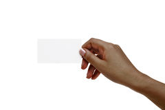 African female hand holds white card on a white background. Royalty Free Stock Photos