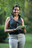 African Female Holding a Touch Pad Tablet PC Royalty Free Stock Image