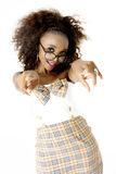 African Female Model  with Spectacles Pointing at Camera. Beautiful African Female Model Wearing a Tartan Dress with a Bow, Pink Lips, Spectacles, Pointing Stock Photo