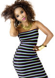 African Female Model Wearing Striped Dress, Gold Jewellery. Beautiful African Female Model with Hand in Her Hair, Wearing Dress with Horizontal Stripes, Big Afro Stock Image