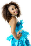 African Female Model Wearing Turquoise Feathered Dress, Big Afro, Sideways Stock Photo