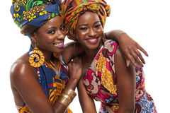 African female models posing in dresses. African female models posing in colorful dresses royalty free stock image