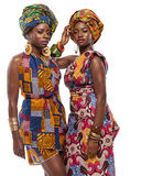 African female models posing in dresses. African female models posing in colorful dresses royalty free stock photography