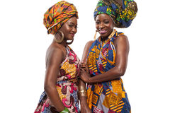 African female models posing in dresses. African female models posing in colorful dresses stock photo