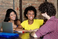 African female student in discussion with caucasian friends stock images