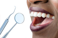 African female teeth with hatchet and mouth mirror. Stock Image