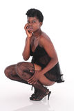 African female in underwear crouching Royalty Free Stock Photo