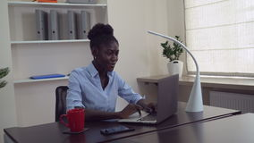 African female use pc at work. Afro american businesswoman working in office. Young professional woman sitting at the working place typing on computer. Happy stock footage