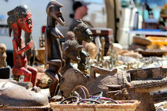 African figures on the flea market Stock Photos