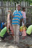 African fisherman and catfish Stock Image