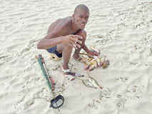 African fisherman. Fishing on Zanzibar. African fisherman shows catch fish from the Indian Ocean stock photos