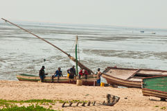 African fisherman in Mozambique. Traditional fishermen and boats on a sandy beach in Mozambique, Africa Stock Photography