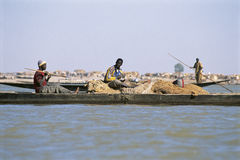 African fisherman pinnace navigating the river Niger Stock Images