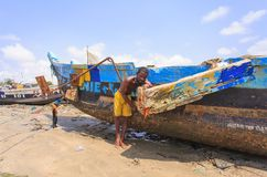 African fisherman woking in hot sunlight Royalty Free Stock Photo