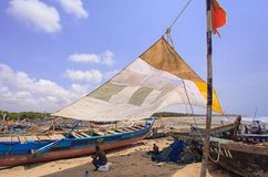 African fisherman woking in hot sunlight Royalty Free Stock Photo