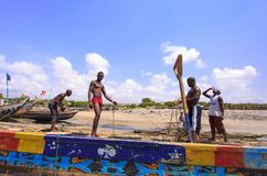 African fisherman woking in hot sunlight Stock Images
