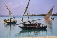 African fishermen on the boat. Coast of Zanzibar island. 13.02.2019 Coast of Zanzibar island , Tanzania, Africa. African fishermen on an ancient wooden sailboats stock photo