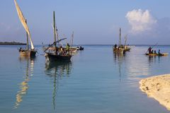 African fishermen on the boat. Coast of Zanzibar island. 13.02.2019 Coast of Zanzibar island , Tanzania, Africa. African fishermen on an ancient wooden sailboats stock images