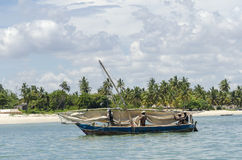 African fishermen dowse sail Royalty Free Stock Images