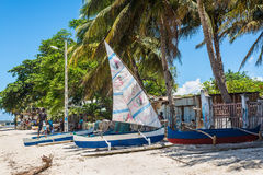 African fishermen and traditional malagasy wooden boat piroga in Royalty Free Stock Photography