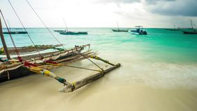 African fishing sailing boat with oars in water near a shore, timelapse stock video