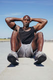 African fitness model exercising outdoors. Royalty Free Stock Photo