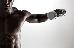 African fitness model working out with dumbbells stock photography