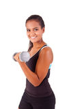 African fitness woman working out with free weights Stock Photo