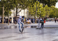 African French young male jumps. While skating at Republic Square in Paris Royalty Free Stock Images