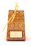 African gift box. A beautiful African present box in leopard skin pattern with blank gift tag. Image isolated on white studio background Royalty Free Stock Photo