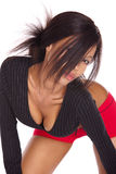 African girl. Voluptuous african girl with red short trousers and black top Royalty Free Stock Photography