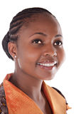 African girl. Portrait of young african girl with orange, brown top Royalty Free Stock Image