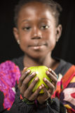 African girl with an apple Stock Photography