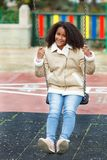 African girl with a beautiful hair in a playground Royalty Free Stock Images