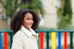 African girl with a beautiful hair in a playground Royalty Free Stock Photos
