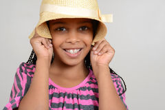 African Girl being silly with hat Royalty Free Stock Photos