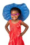 African girl with big blue hat. Comical portrait of small african girl wearing big blue hat.Isolated on white background Stock Photos