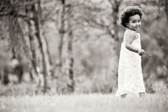 African girl in black and white. African young girl is having fun outside stock photography