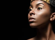 African girl with bright makeup and creative gold Royalty Free Stock Photo