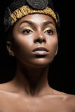 African girl with bright makeup and creative gold Stock Photo