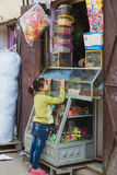 The african girl buys snack from grocery in Morocco Stock Photography