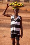 African girl carry things on head Stock Image