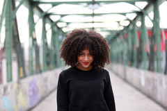 African girl with curly hair. Beautiful African woman standing on a bridge Royalty Free Stock Photography