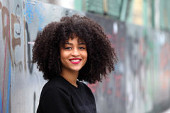 African girl with curly hair. Beautiful African woman standing on a bridge Royalty Free Stock Photo