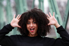 African girl with curly hair. Beautiful African woman standing on a bridge royalty free stock photos