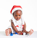 African girl, dressed as Ms. Christmas Astrix. A 8 month old baby dressed to explore Christmas Stock Images