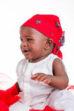 Little girl with red Bandana unhappy and crying. Stock Image
