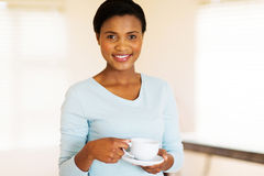 African girl drinking coffee. Portrait of beautiful african girl drinking coffee Stock Images