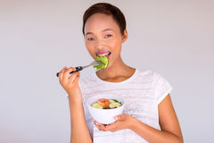 African girl eating salad Royalty Free Stock Images